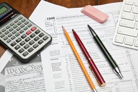federal tax return: The Form 1040, U.S. Individual Income Tax Return, is the starting form for personal (individual) Federal income tax returns Stock Photo