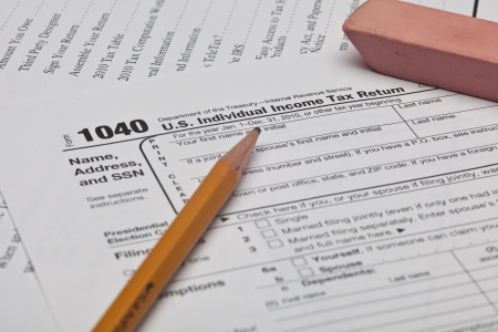 The Form 1040, U.S. Individual Income Tax Return, is the starting form for personal (individual) Federal income tax returns Stock Photo