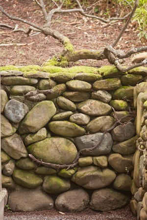 Wall made of stones in traditional Japanese garden. photo