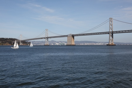 The San Francisco Oakland Bay Bridge is a pair of bridges spanning San Francisco Bay of California, in the United States. Stock Photo - 10393030