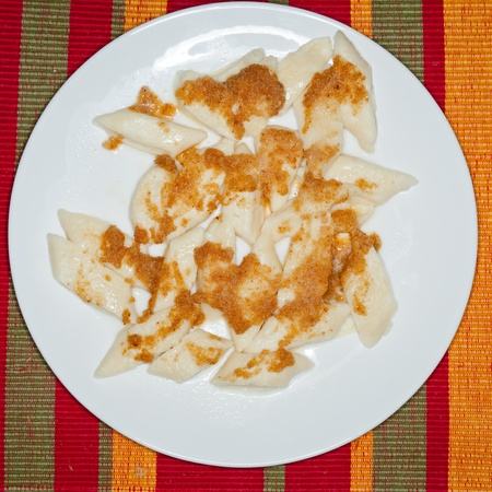 pierogi: Lazy pierogi - dumplings made from cottage cheese , eggs and flour, cooked in lightly salted water.