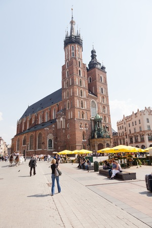 St. Mary's Basilica is a Brick Gothic church re-built in the 14th century (originally built in the early 13th century), adjacent to the Main Market Square in Kraków, Poland.