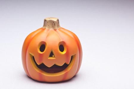 Plastic Halloween Jack o Lantern decoration imitating curved pumpkin. Stock Photo