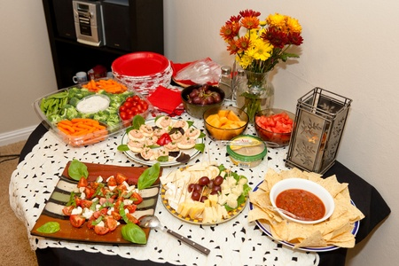 Party table arrangement with assortment of foods.
