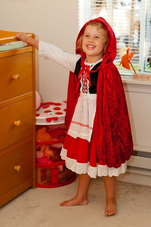 Trying a Little Red Riding Hood costume before Halloween