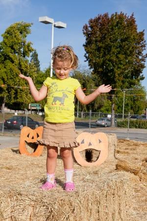 Having fun on pumpkin patch on sunny Sunday. photo