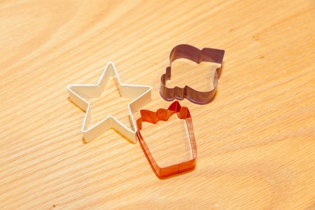 Cookie cutter is a tool to cut out cookiebiscuit dough in a particular shape. photo