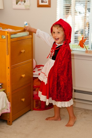 Trying a Little Red Riding Hood costume before Halloween photo