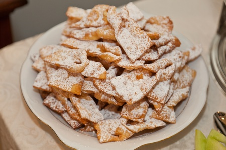 surfeit: Angel wings are a traditional sweet crispy pastry made out of dough that has been shaped into thin twisted ribbons, deep-fried and sprinkled with powdered sugar.