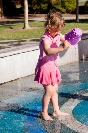 Having fun with water at the playground in park photo