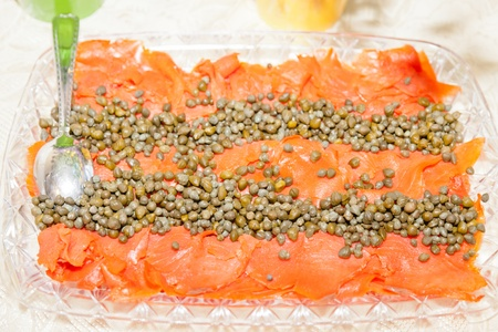 Smoked salmon with capers and dill on large tray. photo
