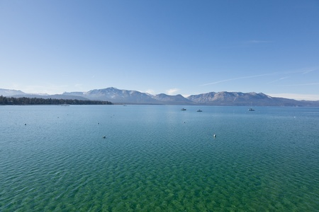 frozen lake: Lake Tahoe is a large freshwater lake in the Sierra Nevada mountains of the United States.