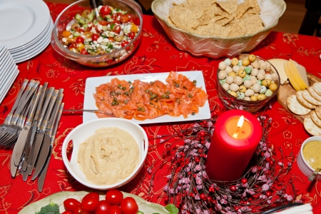 Table with lots of different foods for Christmas party. photo