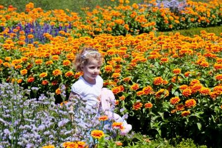 Having fun running around the flower garden. photo