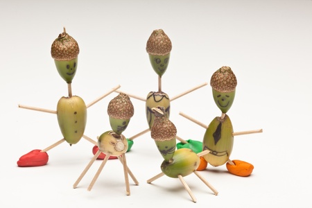 Funny characters made by child from acorns and matches.