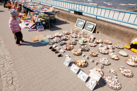 Colofulr souvenir displays on Kolbrzeg Promenade waiting for tourists.