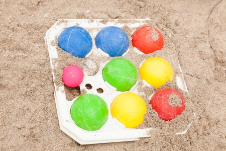 bocce ball: Colorful set of the bocce balls on sand.