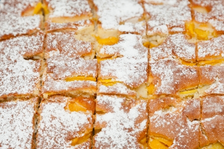 deliciously: Fresh apricots inside a deliciously light sheet cake. Stock Photo