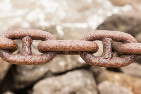 Rusty heavy chain in a port. Stock Photo