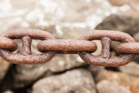 rusty chain: Rusty heavy chain in a port. Stock Photo