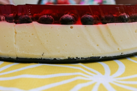 cold: No-bake cold cheesecake with bluberries in red jelly. Stock Photo