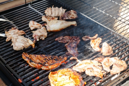 Grilling is a form of cooking that involves dry radiant heat from above or below, and takes place on a grill or griddle. photo