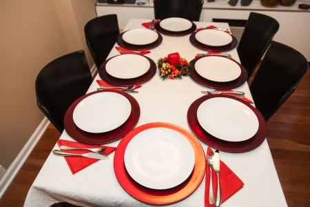 simple decorated christmas dinner table for eight people stock photo 18697510