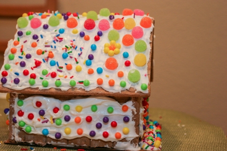 Making gingerbread house together at home before Christmas. photo