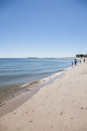 boarders: Compo Beach is a 29 acre park with an extensive sand beach along the shore of Long Island Sound and boarders the Saugatuck River. Stock Photo