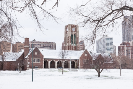michigan snow: Huge Neo-Gothic brick and limestone structure that now serves as restrooms and the pro shop for the Marovitz golf course. Stock Photo