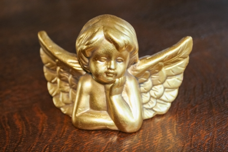 Decorative Christmas angel head figurine on a table. photo