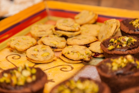 Large selection of assorted cookies on a plate.
