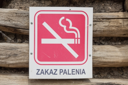 Red no smoking sign on a wooden wall in Biskupin archaeological open air museum. Stock Photo - 22271071