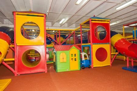 Having fun playing on large indoor playground. Stock Photo - 22409904