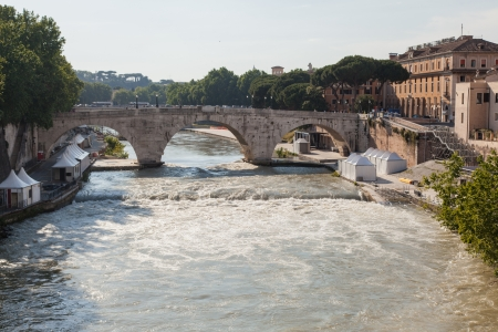 Pons Cestius (Italian: Ponte Cestio is a Roman stone bridge in Rome, Italy, spanning the Tiber to the west of the Tiber Island. Stock Photo