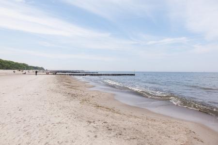 Wide sandy Baltic Sea beach in Kolobrzeg.