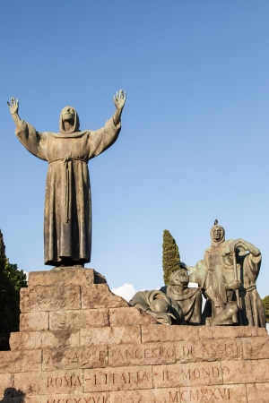 francesco: Statue of St Francis of Assisi stands to the right of the basilica of San Giovanni in Laterano on a large base made from peperino stone.