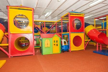 Having fun playing on large indoor playground Stock Photo - 22991594
