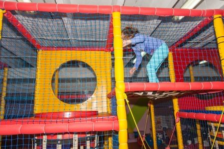 playcentre: Having fun playing on large indoor playground.