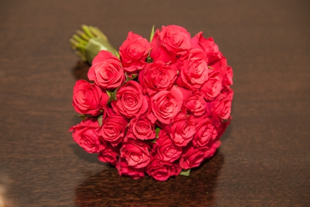 Traditionally the bride will hold the bouquet, and the maid of honor will hold it during the ceremony.