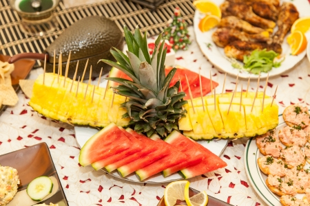 l plate: Party table arrangement with assortment of foods.