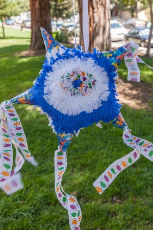 Homemade piñata filled with small toys or candy made for birthday party. photo