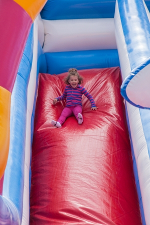 Having fun playing in inflatable jump house. 版權商用圖片