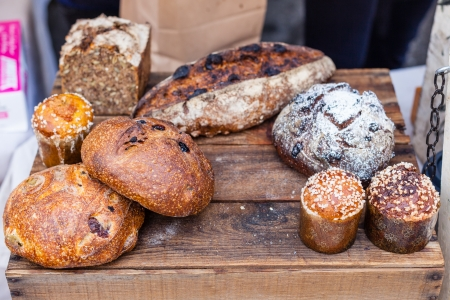 Delicious artisan breads for sale at local farmers market.