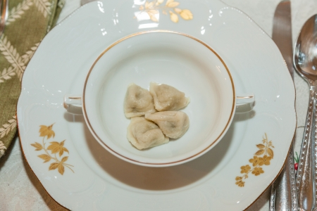 Uszka are small dumplings (a very small and twisted version of pierogi) usually filled with flavoursome wild forest mushrooms andor minced meat. photo