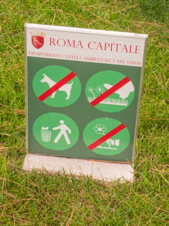 Sign prohibiting walking on grass, picking flowers and littering.