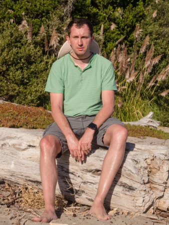 washed out: Sitting on a washed out log on the beach.
