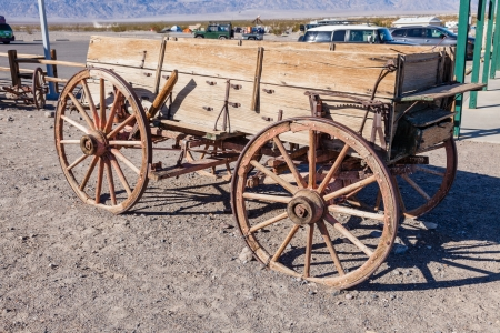 Buckboard is a four-wheeled wagon of simple construction meant to be drawn by a horse or other large animal. photo