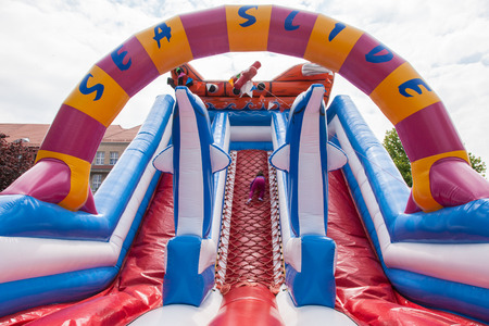 Having fun playing in inflatable jump house. Standard-Bild