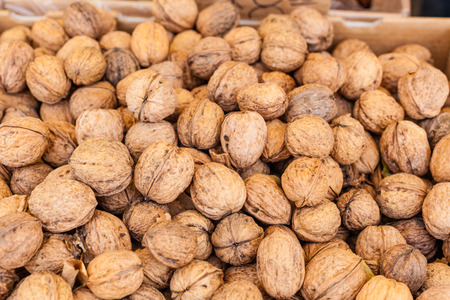 Pile of organic walnuts for sale at local farmers market. Stock Photo